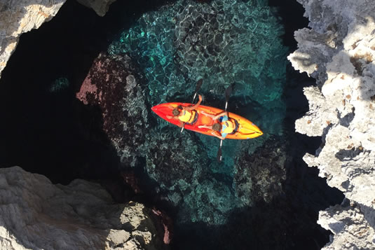 Menorca by kayak is a unique experience because it allows us to admire bays and beaches accessible only by sea