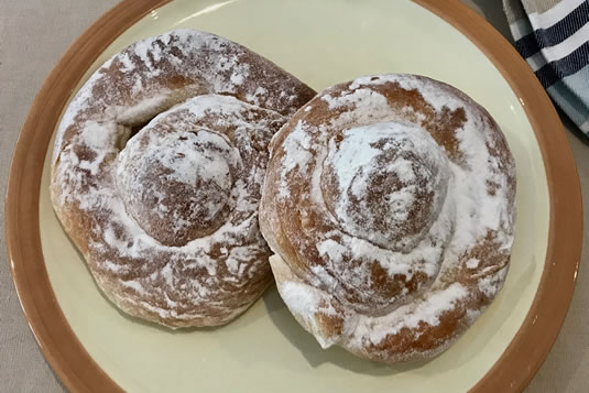 Balearic specialties: ensaimada, very soft brioche made in a spiral sprinkled with powdered sugar
