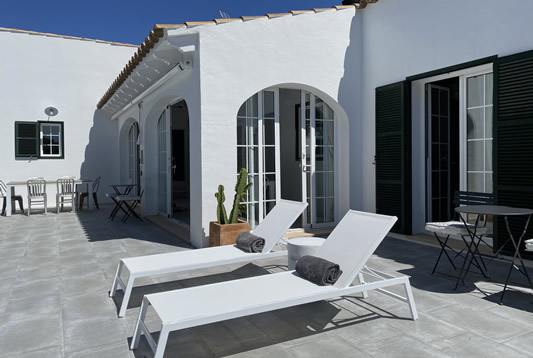 Casa Bonita Menorca is a white villa with saltwater pool